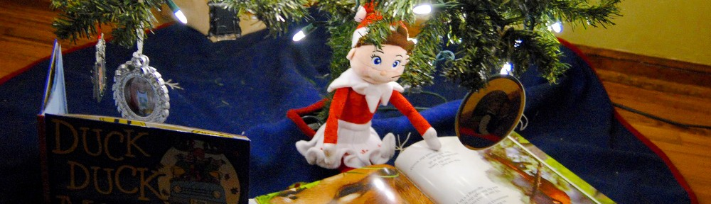 Our Elf on the Shelf Reading While Sitting Under the Christmas Tree|Sharon the Moments blog